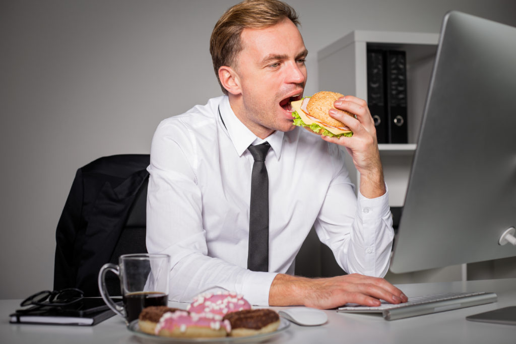 businessman eating lunch at desk